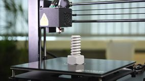 3D printer printing a gray screw. Remove the screw at the end of the 3d printer printing a big gray screw stock footage