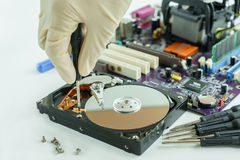Remove screw from Hard Disk Drive Stock Photography