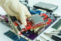 Remove VGA card from main circuit board Stock Photos