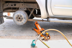 Remove wheel by car jack for repair with tool. Royalty Free Stock Photos