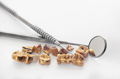 Removed from teeth old golden dental bridge Stock Photos