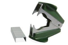Removedor e grampos verdes do grampo Fotografia de Stock