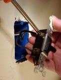 Removendo um interruptor velho imagens de stock
