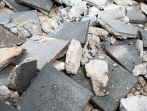 Footpath reconstruction. Removes old sidewalk. Footpath reconstruction. Footpath repair. Pile of dirty gray curb bricks Royalty Free Stock Images