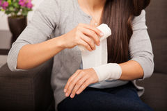 Removing a bandage at home Royalty Free Stock Photography