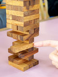 Removing blocks from a tower. royalty free stock photo