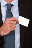 Removing business card from pocket Royalty Free Stock Photos