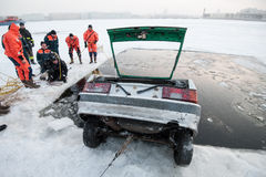 Removing the car out of the ice-hole Royalty Free Stock Photo