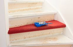 Removing carpet, glue and paint from an vintage stairs Stock Image