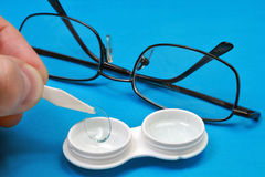 Removing the contact lens from its case Royalty Free Stock Photo
