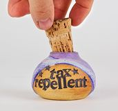 Removing cork to bottle of tax repellent