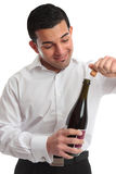 Removing cork from wine Royalty Free Stock Images