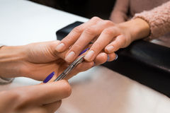 Removing the cuticle by manicure nippers Royalty Free Stock Photos