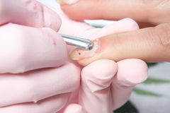Removing cuticle from the nail. Manicure. Removing cuticle from the nail Stock Photography
