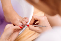 Removing cuticle Royalty Free Stock Photo
