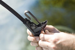 Removing the damaged wiper from the arm. 