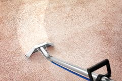 Removing dirt from carpet with professional cleaner indoors. Removing dirt from carpet with professional vacuum cleaner indoors royalty free stock images