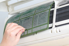 Removing dirty air-conditioner filter Royalty Free Stock Image