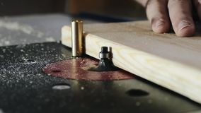 Removing an edge from a tree using a milling machine. Close-up. Slow motion.