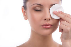 Removing eye make-up. Stock Images