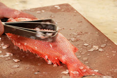 Removing Fish Scales Royalty Free Stock Photography