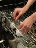 Removing glasses from the dishwasher Royalty Free Stock Photo