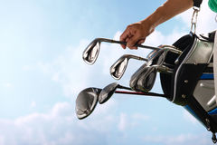 Removing golf club from bag Stock Photography