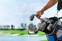 Removing golf club from bag Stock Images