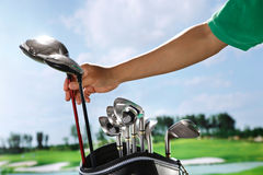 Removing golf club from bag Stock Image