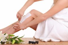 Removing hair from woman leg. S Royalty Free Stock Images