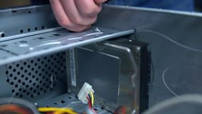 Removing hard drive from personal computer PC. Staff at service center removing parts from personal computer for maintanance stock footage