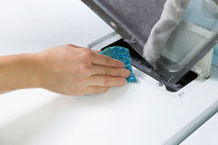 Removing the Lent out of Dryer Air Filter Screen Stock Photos