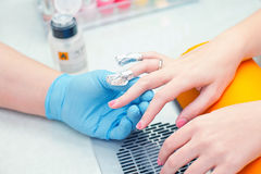 Removing manicure with acetone Stock Images