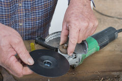 Removing Metal Bush from Angle Grinder. Stock Photos