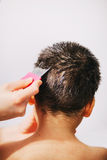 Removing lice and nits from the hair Stock Photos