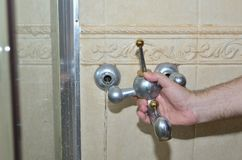 Removing old bathroom tap royalty free stock photos