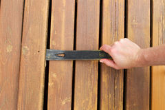 Removing old wooden boards with Pry Bar Stock Photos