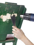 Removing paint using a heat gun. And trowel Royalty Free Stock Images