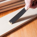 Removing paint from a wood surface. Using a spackle knife Royalty Free Stock Photography