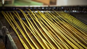 Clean up the piano strings. Removing the piano strings while repairing stock video