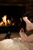 Removing shoes by fire Royalty Free Stock Photo