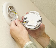 Removing Smoke Detector To Change The Battery Stock Photos
