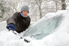 Removing snow from the car Royalty Free Stock Photos