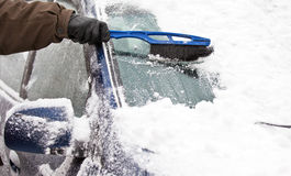 Removing snow from car Royalty Free Stock Photography