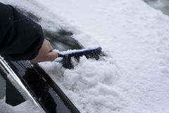 Removing Snow from the Car windshield. After Blizzard Royalty Free Stock Images