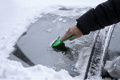 Removing Snow from the Car windshield. After Blizzard Stock Photos