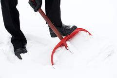 Removing snow with a shovel Stock Photos