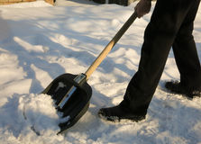 Removing snow with a shovel after snowfall. In the winter Royalty Free Stock Photo