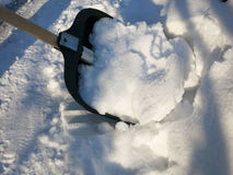 Removing snow with a shovel after snowfall. In the winter Royalty Free Stock Images