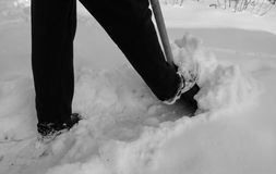 Removing snow with a shovel after snowfall Royalty Free Stock Photo
